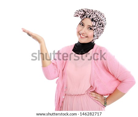 Portrait of a young muslim woman showing blank area for sign or copyspace - stock photo