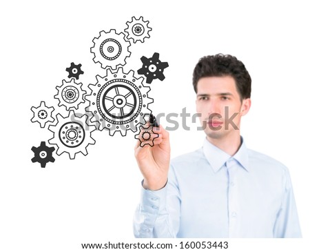 Portrait of a young pensive businessman holding a marker and drawing a concept of business development process. Isolated on white background.  - stock photo