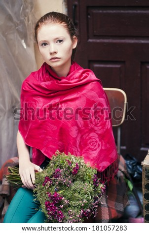 portrait of a young redhead girl with flowers - stock photo