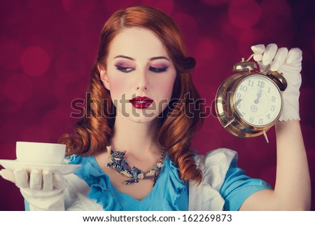 Portrait of a young redhead woman dressed as Alice in Wonderland, video game. - stock photo