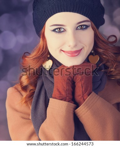 Portrait of a young redhead women. Photo with bokeh at background. - stock photo