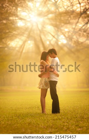 Portrait of a young romantic couple embracing, Outdoor portrait - stock photo