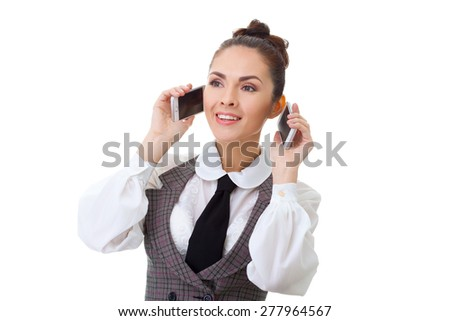 Portrait of a young secretary talking on phone with two persons at the same time - stock photo