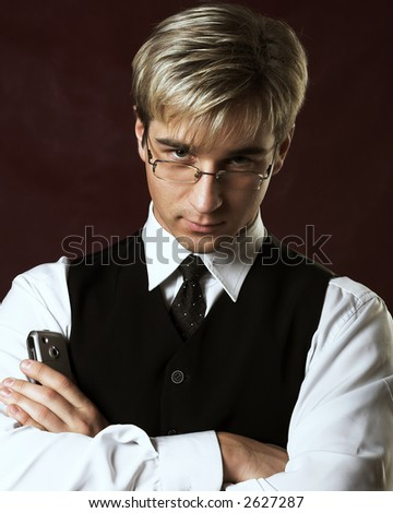Portrait of a young serious businessman - stock photo