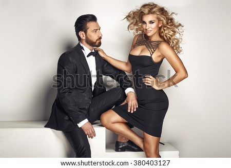 Portrait of a young smart couple - stock photo