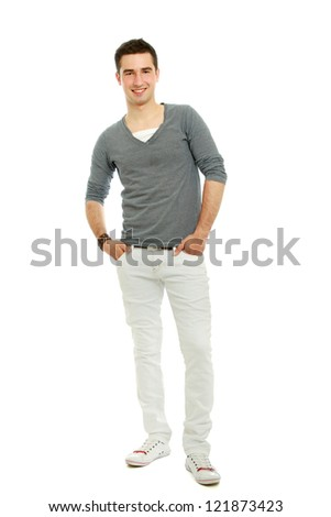 Portrait of a young smiling guy with hands in pockets , isolated on white background - stock photo