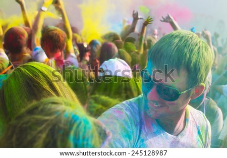 Portrait of a young smiling man on holi color festival - stock photo