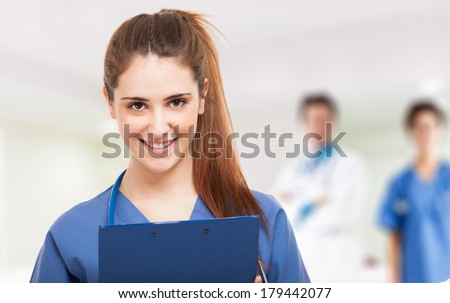 Portrait of a young smiling nurse - stock photo