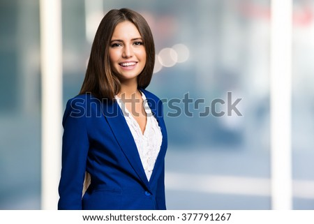 Portrait of a young smiling woman - stock photo