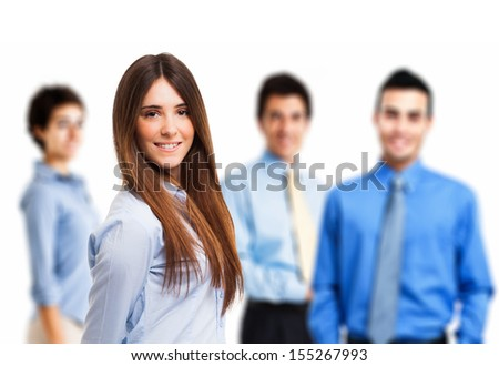 Portrait of a young smiling woman in front of a group of people - stock photo