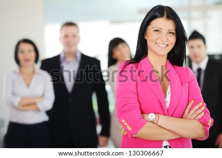 Portrait of a young successful business team at office - stock photo