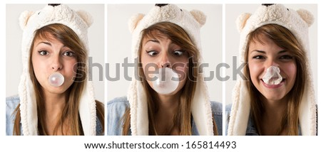 Portrait of a young woman blowing bubblegum against a white background  - stock photo