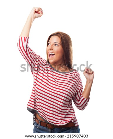 portrait of a young woman doing a winner gesture - stock photo
