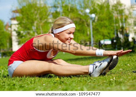Portrait of a young woman doing physical exercise in natural environment - stock photo