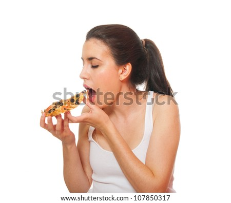 Portrait of a young woman eating. Isolated on white. - stock photo