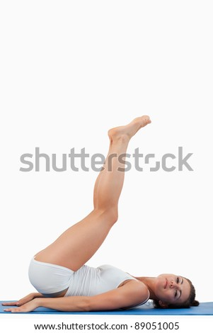 Portrait of a young woman exercising against a white background - stock photo