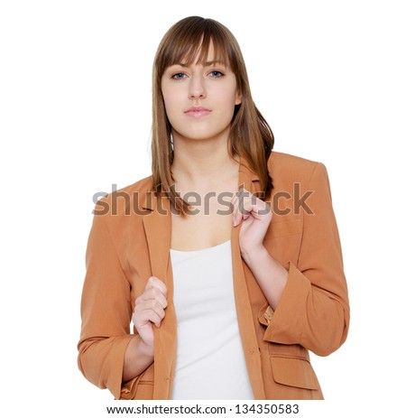 Portrait of a young woman holding jacket - stock photo