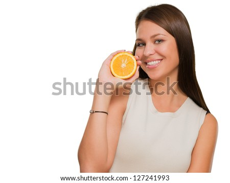 Portrait Of A Young Woman Holding Orange On White Background - stock photo