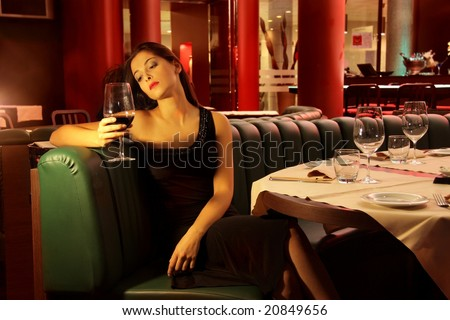 portrait of a young woman in a restaurant - stock photo