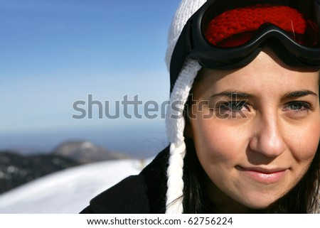 Portrait of a young woman in a snowy landscape - stock photo