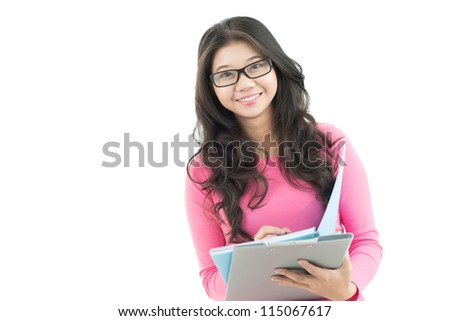 Portrait of a young woman in eyeglasses looking at camera with folder - stock photo