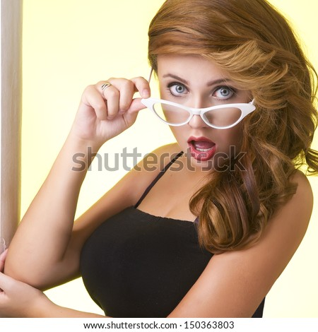 Portrait of a young woman in glasses - stock photo