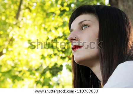 Portrait of a young woman in nature - stock photo