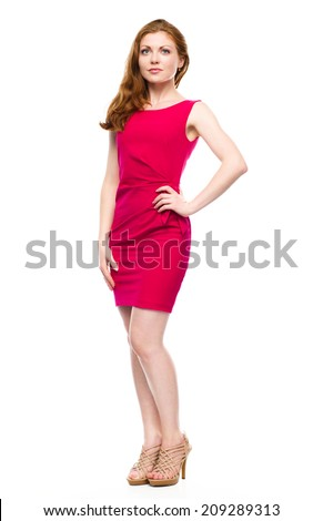 Portrait of a young woman in red dress, isolated over white - stock photo