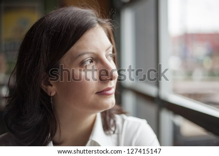 Portrait of a young woman looking away from the camera. - stock photo