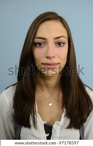 portrait of a young woman on yellow background - stock photo