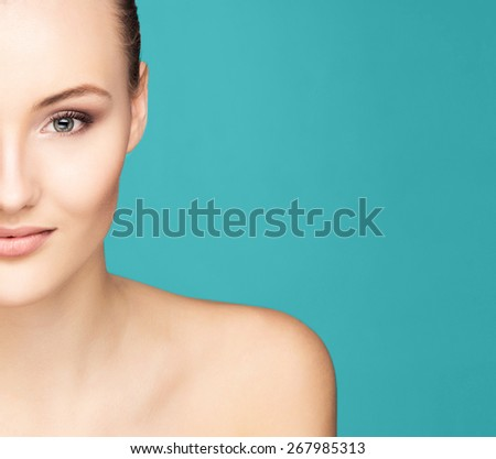 Portrait of a young woman over green background - stock photo