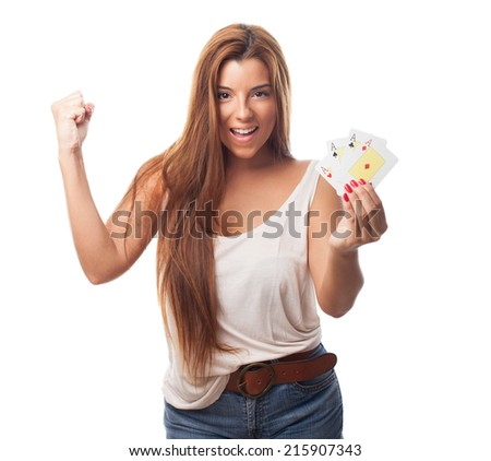 portrait of a young woman playing poker and doing a winner gesture - stock photo