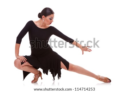 portrait of a young woman salsa dancer in a lunge dance pose. isolated on white background - stock photo