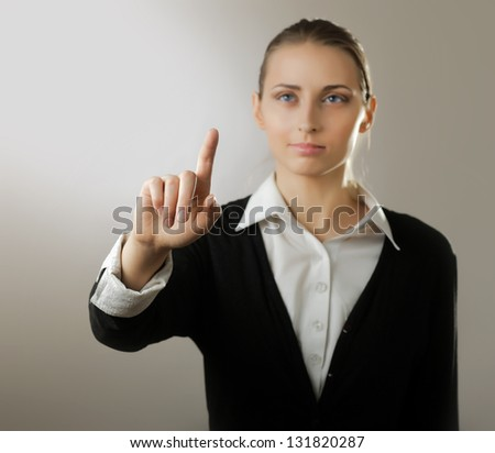 Portrait of a young woman showing something - stock photo