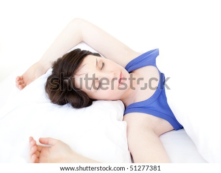 Portrait of a young woman sleeping against a white background - stock photo