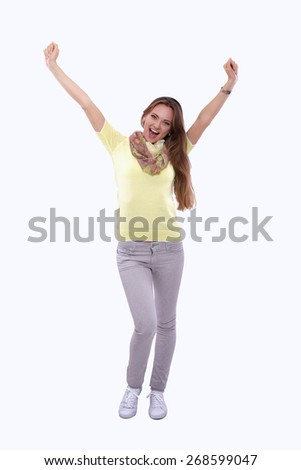 Portrait of a young woman standing, hand up - stock photo