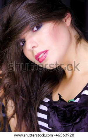 portrait of a young woman with a long brunette hairs - stock photo