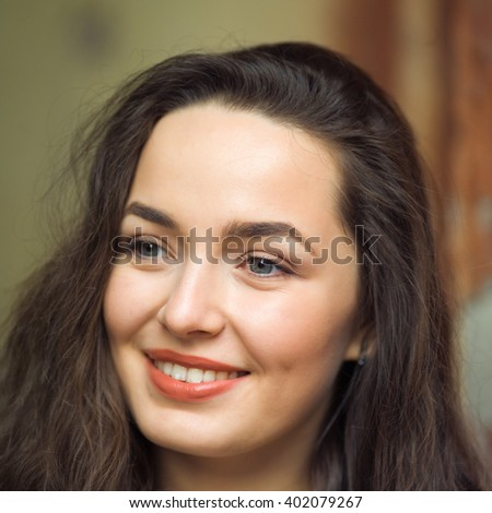 Portrait of a young woman with beautiful eyes - stock photo