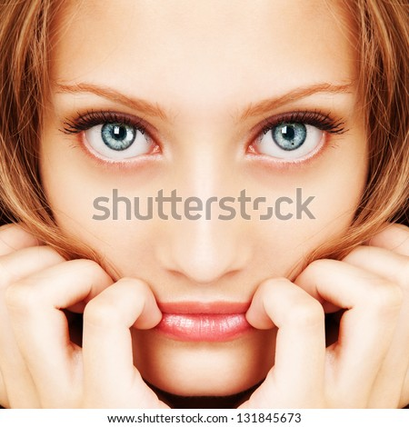 Portrait of a young woman with beautiful hair and blue eyes - stock photo