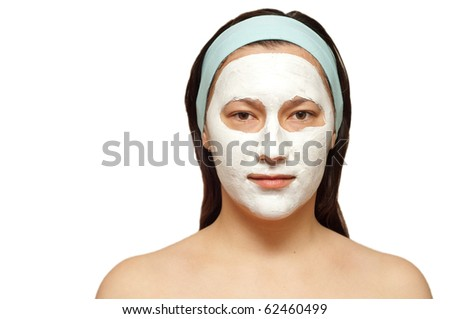portrait of a young woman with beauty mask on her face isolated - stock photo