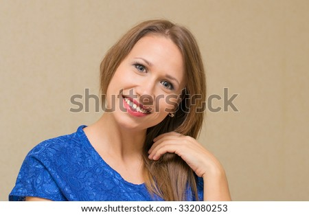 portrait of a young woman with brown hair indoors - stock photo