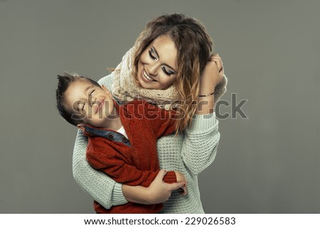 Portrait of a young woman with her son   - stock photo