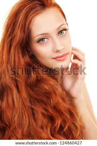 Portrait of a young woman with red hair and green eyes - stock photo