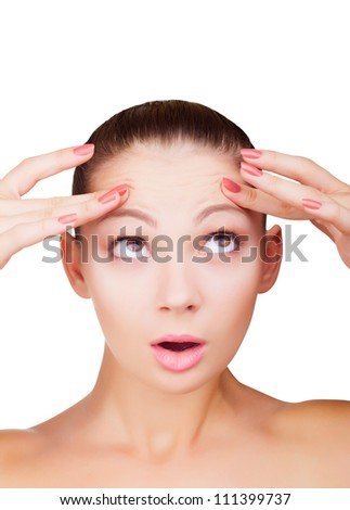 Portrait of a young woman with wrinkles on his forehead isolated on white background - stock photo