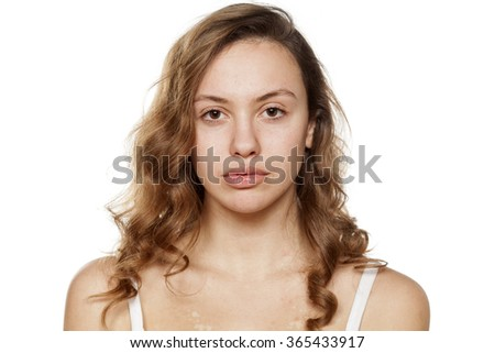 portrait of a young woman without make-up - stock photo