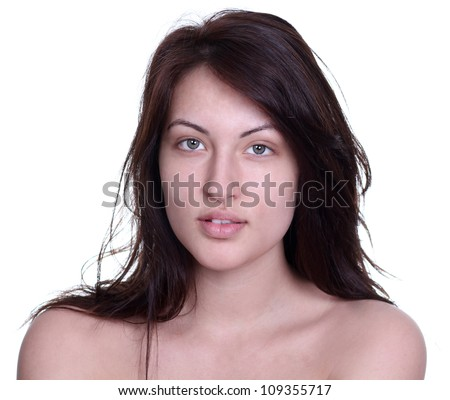 portrait of a young woman without makeup - stock photo