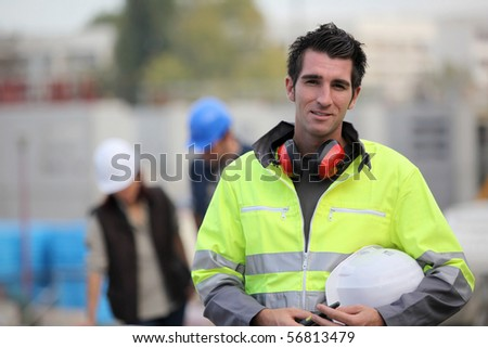 Portrait of a young worker on a site - stock photo