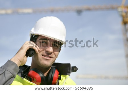 Portrait of a young worker with walkie-talkie - stock photo