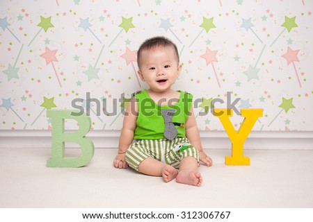"Portrait of adorable asian baby boy with letter wooden ""BOY"" - stock photo"