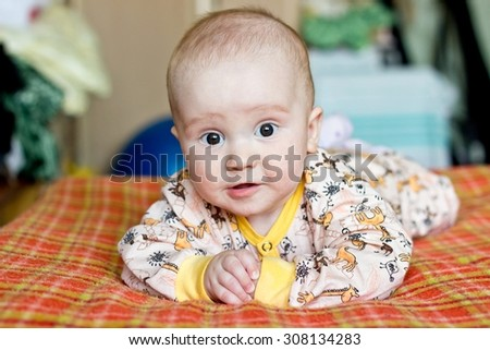 Portrait of adorable baby boy - stock photo